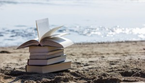 Books on beach sand