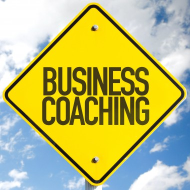 Business Coaching sign with sky background